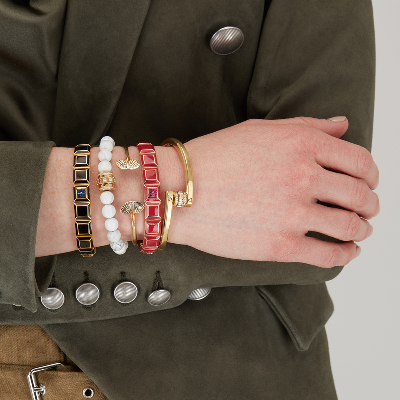 A chic stack of bracelets from your favorite designers adds an instant edge to any outfit.
