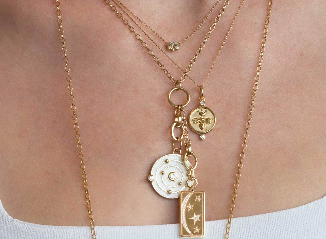 Get inspired to create your own neck mess with some of our favorite Monica Rich Kosann charm pieces